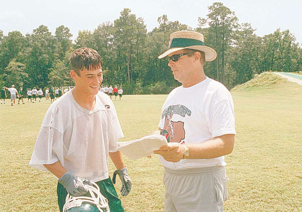 The Woodlands wide receiver Danny Amendola, left, goes over offensive plans with head coach Weldon Willig in 2002.