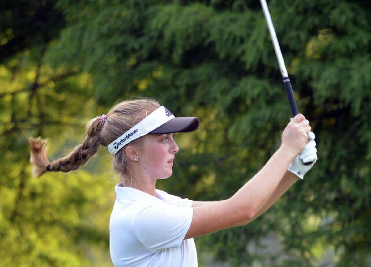 Father McGivney's Ellie Hyten watches her shot during a tournament last season. Hyten and Julia Stobie each shot a 3-over 38 on Wednesday to set the program record for the lowest 9-hole score.