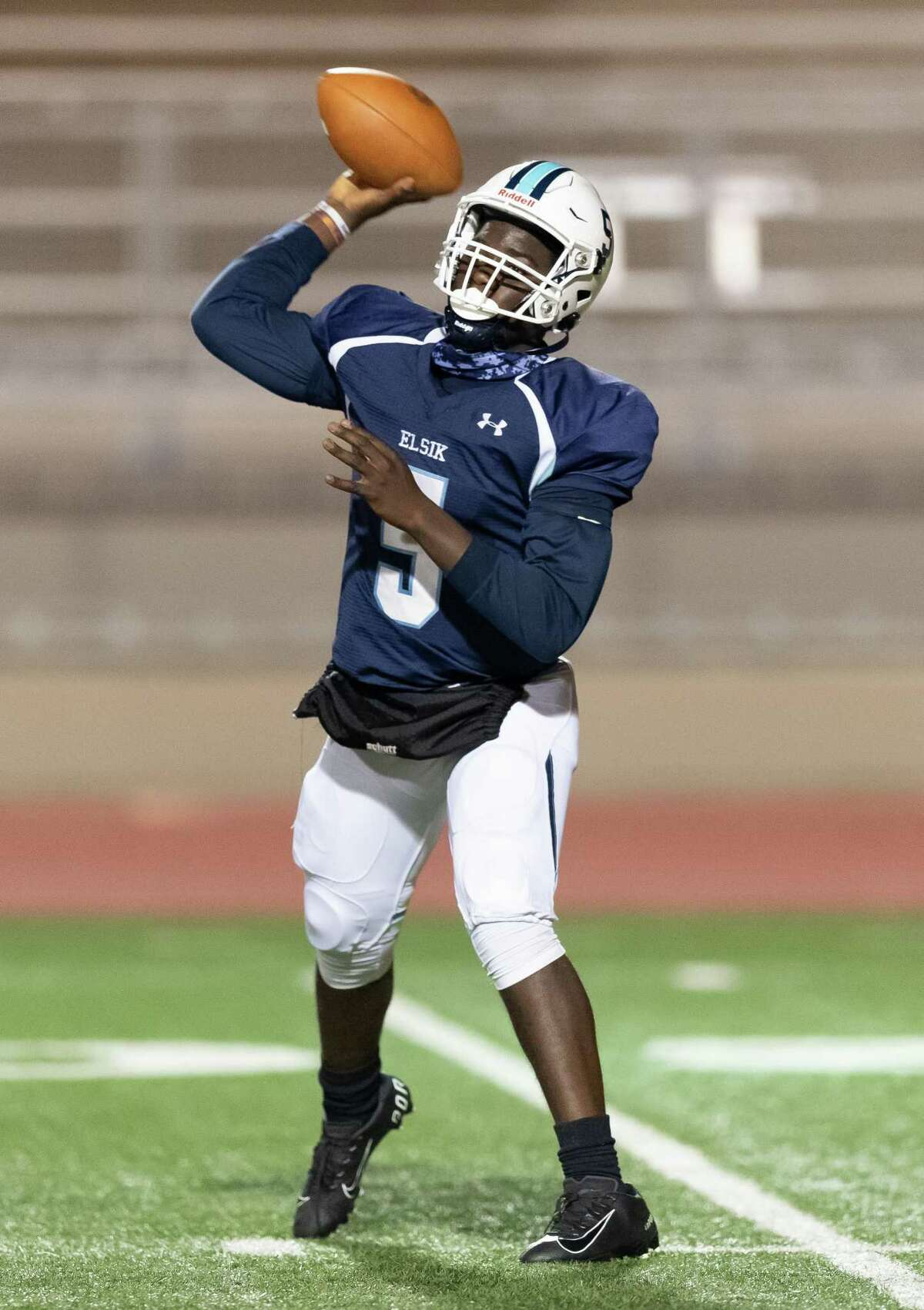 Eric Dadzie (5) of the Alief Elsik Rams attempts a pass in the first half against the Alief Taylor Lions during a High School football game on Friday, October 16, 2020 at Crump Stadium in Houston Texas.