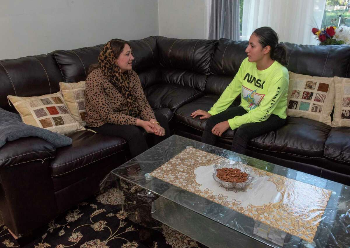 Shirin Karimi, left, a former refugee who came to the Capital Region from Afghanistan to build a new life for herself, sits with her daughter Sadaf Ahmadi in their home on Wednesday, Sept. 8, 2021 in Albany, N.Y.