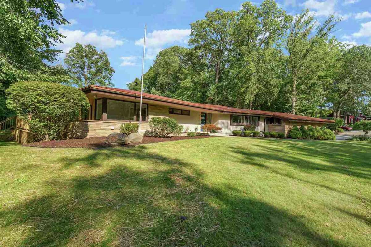 This home is for sale on 1200 W Sugnet Road in Midland.