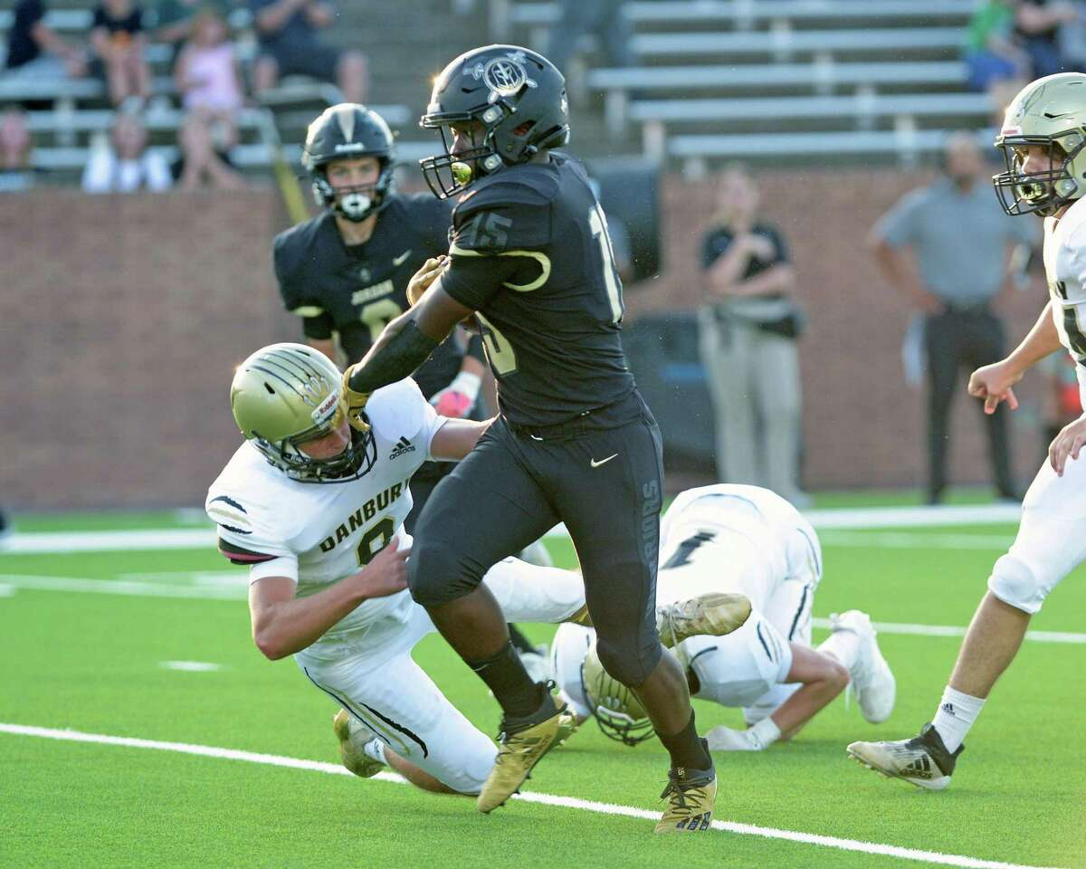 Ifeanyi Monye (15) of Jordan scores the first touchdown of the first quarter during a non-District football game between the Jordan Warriors and the Danbury Panthers on Friday, September 3, 2021 at Rhodes Stadium, Katy, TX.