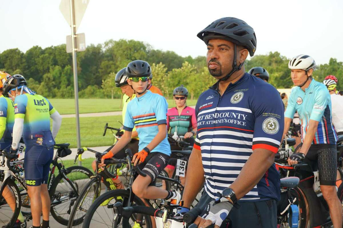 """Fort Bend County District Attorney Brian Middleton gets ready to lead cyclists out on Saturday, Sept. 4, at Brazos River Park in Sugar Land for the first """"Bike Ride for Survivors"""" he started to raise funds for domestic violence survivors."""