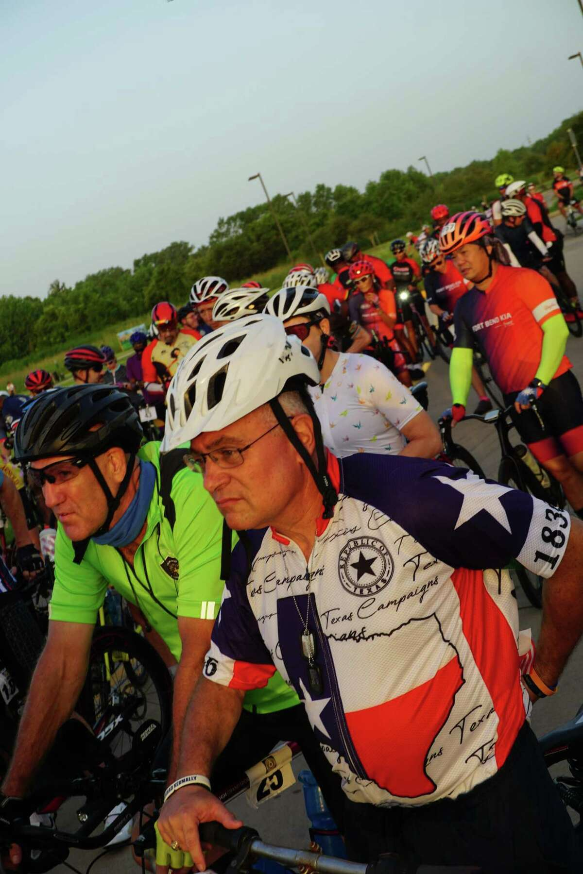 """Cyclists wait for the first """"Bike Ride for Survivors"""" to start on Saturday, Sept. 4, at Brazos River Park in Sugar Land. Fort Bend County District Attorney Brian Middleton started the ride to raise funds for domestic violence survivors."""