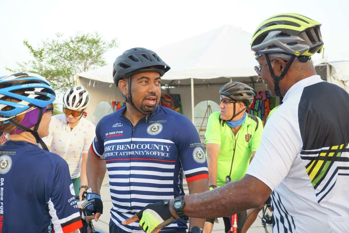 """Fort Bend County District Attorney Brian Middleton chats with fellow cyclists before the start of the first """"Bike Ride for Survivors"""" on Saturday, Sept. 4, at Brazos River Park in Sugar Land. He started the ride to raise funds to support domestic violence survivors."""