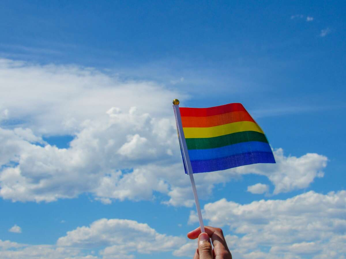 The pride flag represents the LGBTQ+ community.