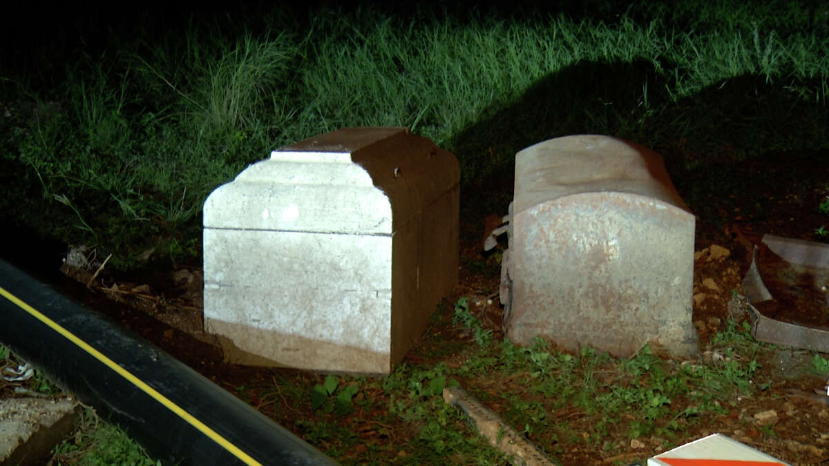 The San Antonio Public Works Department said one of its contractors is responsible for leaving two caskets on the side of a Northwest Side street.