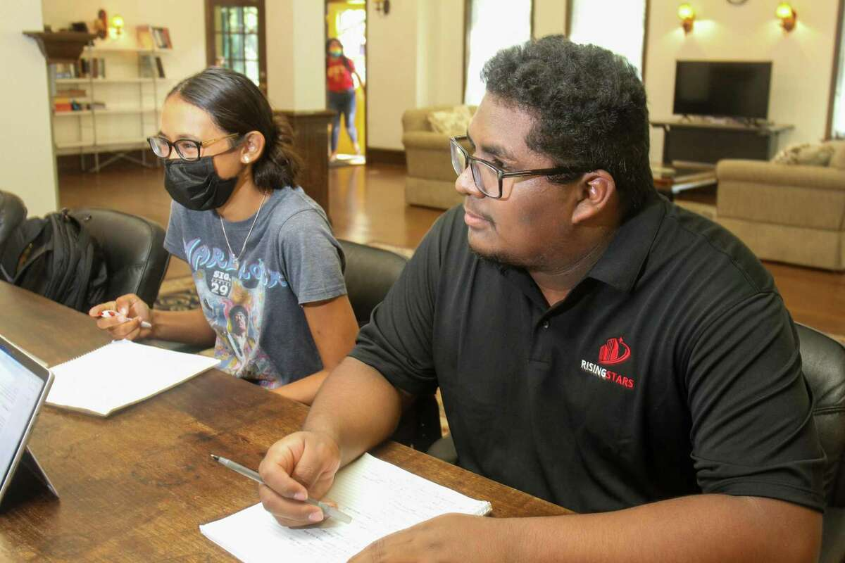 Brisa Evans and Yahir Ortega, students at the University of St. Thomas, study in the Rising Stars lounge at The Black Lab. The Black Labrador, a Montrose mainstay for 33 years, has been converted to a space for current and past University of St. Thomas students and staff, who still call it the Black Lab.