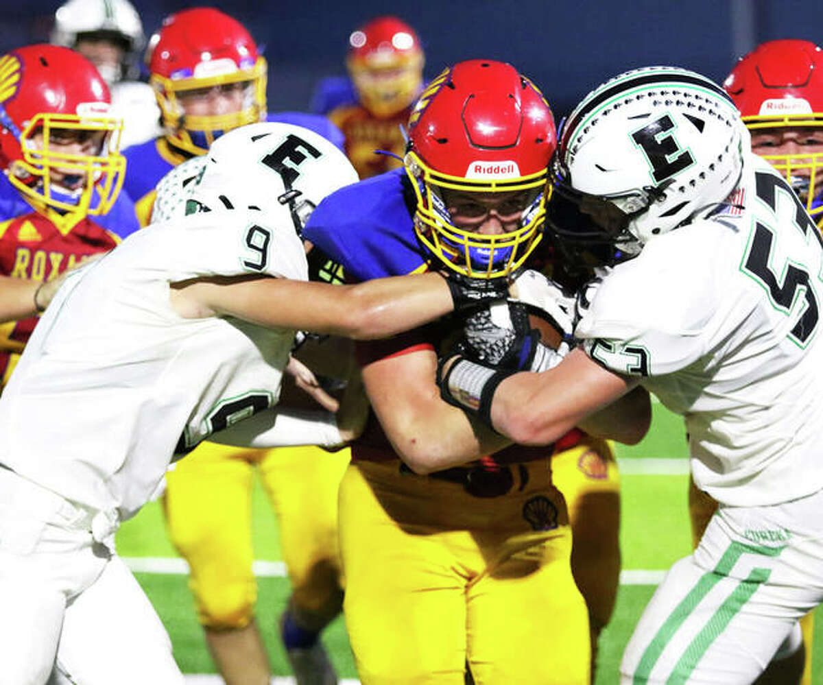 Roxana's Evan Wells (middle) holds onto the football while two Eureka defenders try to strip it away during a Week 1 game at Raich Field in Roxana. Wells, a sophomore, has rushed for 312 yards and six TDS for the 1-1 Shells, who play at Civic Memorial on Friday night in Bethalto.