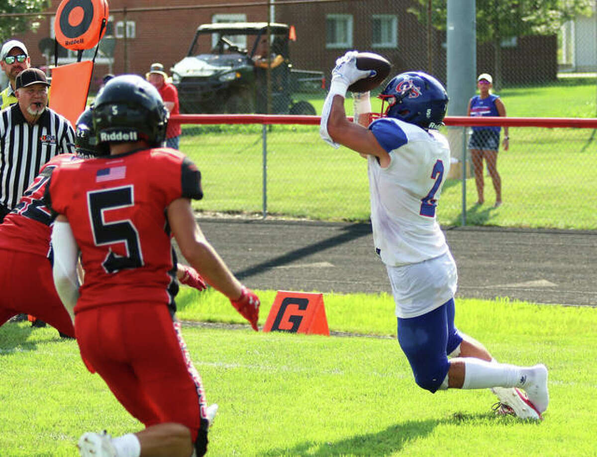 Carlinville's Carson Wiser (right) catches a TD pass in the corner of the end zone behind two Gibson City-Melvin-Sibley defenders in a Week 1 game at Gibson City. In two games, Wiser has 23 receptions for 389 yards and five TDs.