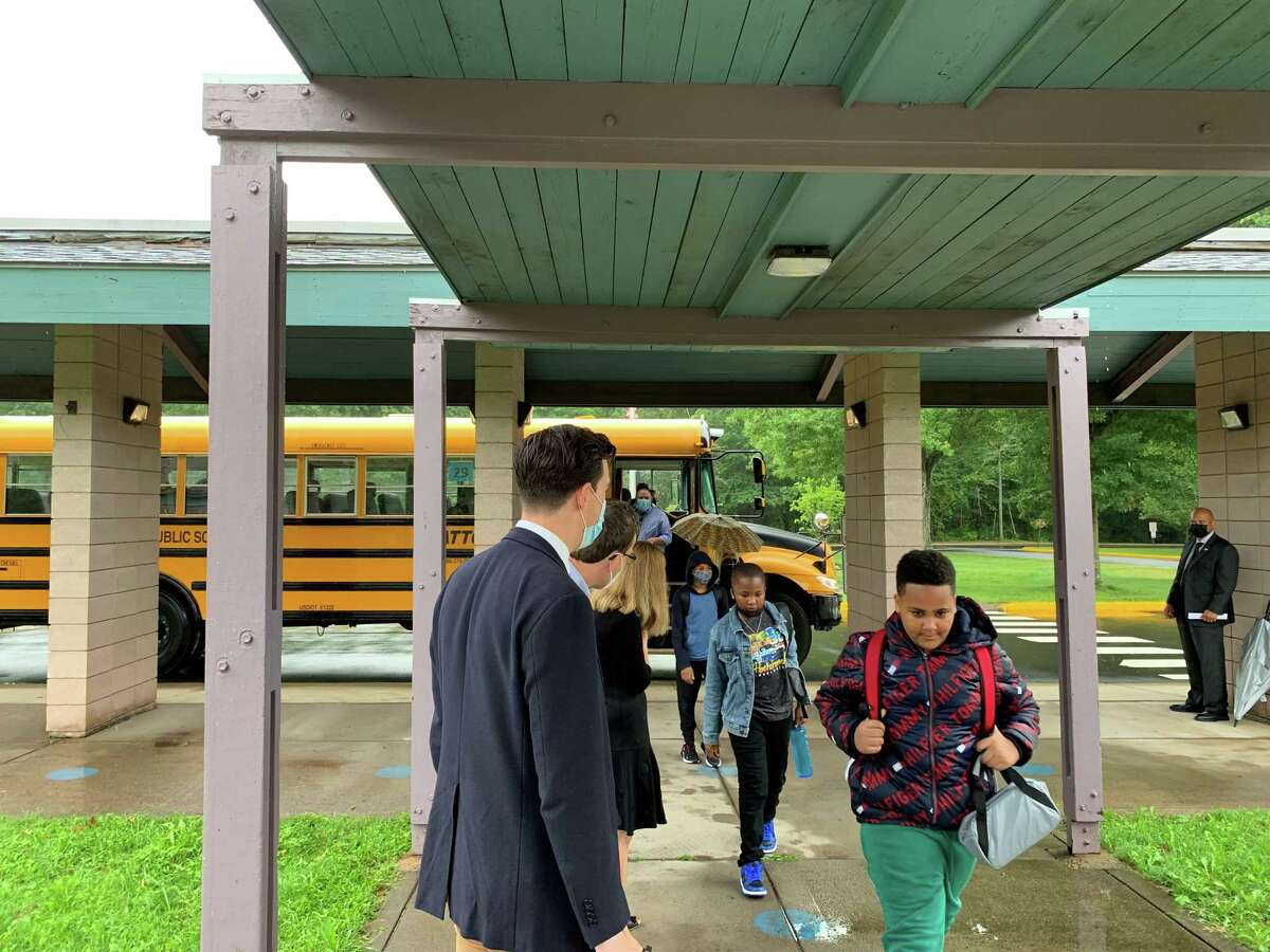 Mayor Ben Florsheim, left, greeted Lawrence Elementary School students on Kaplan Drive Thursday morning, welcoming them back to the facility on the first day of classes.