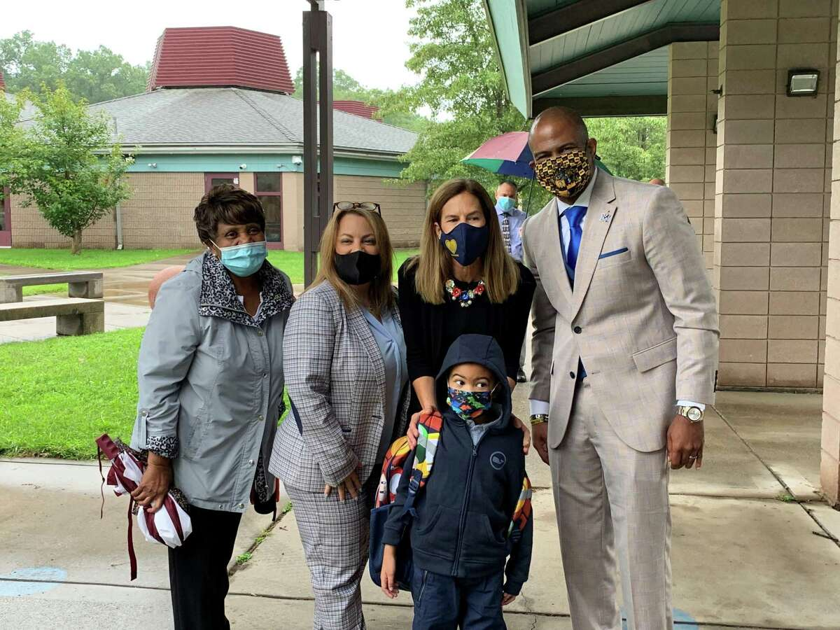 Lt. Gov. Susan Bysiewicz, second from right, poses for a photograph with the family of Middletown Schools Superintendent Michael Conner, right, at Lawrence Elementary School Thursday morning.