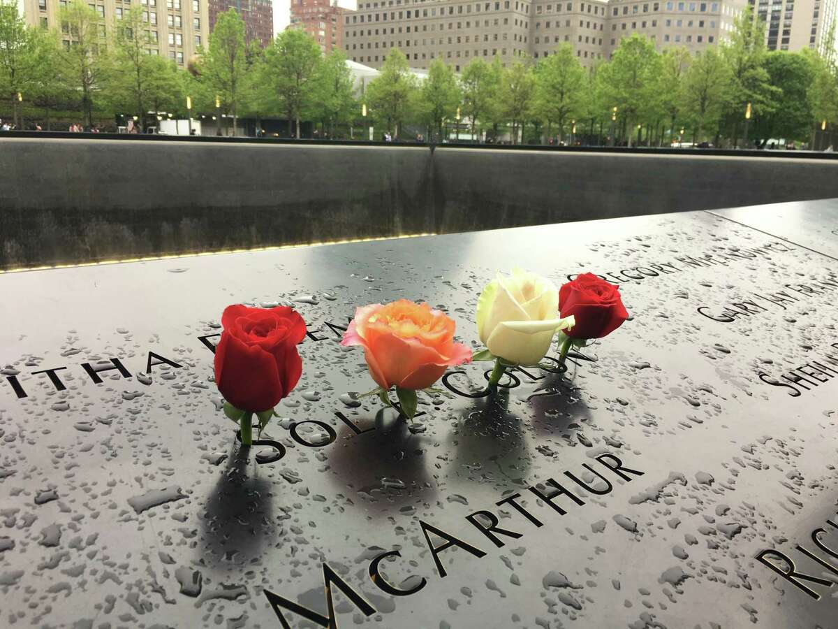 Flowers decorate Sol Colon's name at the 9/11 Memorial & Museum in Lower Manhattan in 2018. Business reporter Shayla Colon spoke with her dad about her mother's death in the South Tower collapse, and the impact that tragic loss has had on their lives.