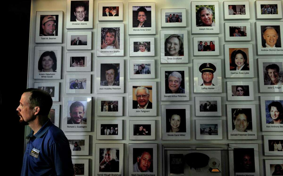 The Flight 93 National Memorial in Shanksville, Pa., includes photos of the 40 passengers and crew members. Gordon Felt, left, lost his brother Edward on the flight.