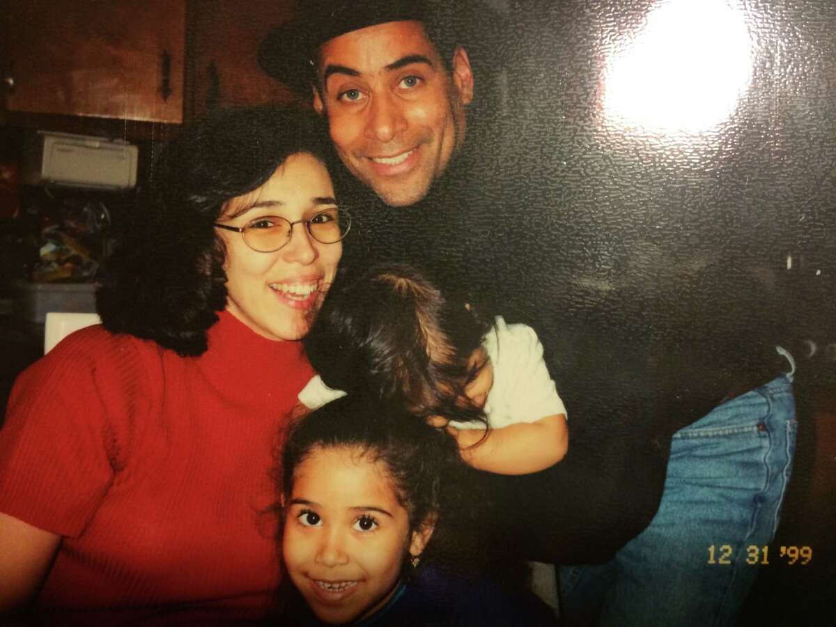 Sol and Ben Colon with their daughters, Alexis (bottom) and Shayla, on New Year's Eve 1999.