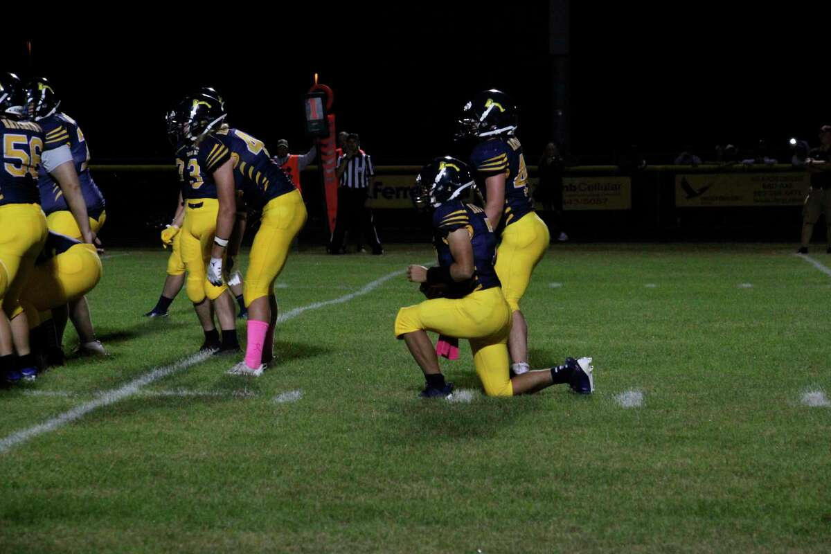 Griffin Meinhold takes a knee to seal the 42-0 victory by Bad Axe over Cass City in Week 2. (Tom Greene/Huron Daily Tribune)