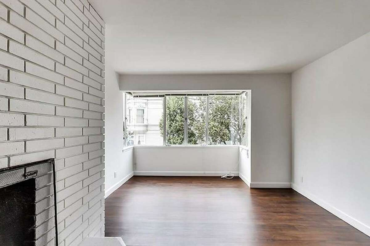 The unit is just blocks from Lafayette Park and looks relatively spacious. It even has a cute brick fireplace.