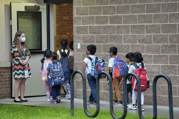 Students make their way into Menands School on the first day of classes on Thursday, Sept. 9, 2021, in Menands, N.Y.