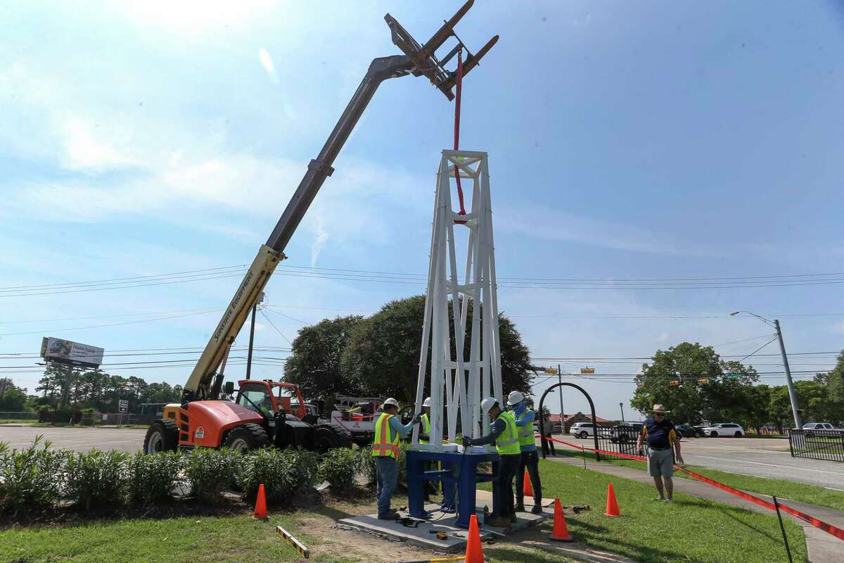 Architect Mike Porterfield watches as the AVAdeck Inc. crew sets the tower component atop the Peace monument at Clear Lake Park on September 8, 2021 in Houston, TX.Peace monument at Clear Lake Park on September 8, 2021 in Houston, TX.