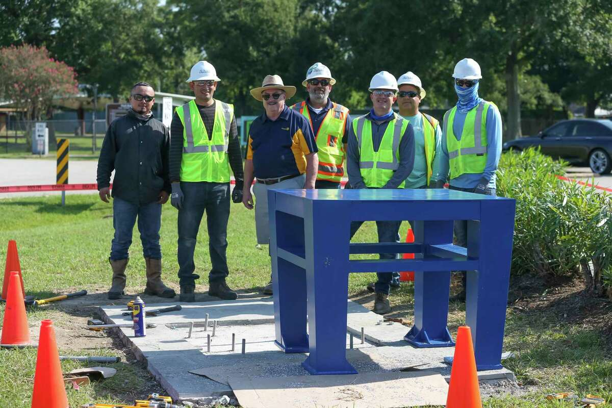 Mike Porterfield and AVAdek Inc. crew members stand behind the platform piece that will support the Peace monument, at Clear Lake Park on September 8, 2021 in Houston, TX.