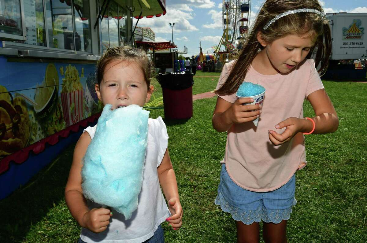 Visitors enjoy the Norwalk Seaport Association 42nd annual Oyster Festival Saturday, September 7, 2019, in Norwalk, Conn. The event returns this weekend after not being held last year due to the pandemic.