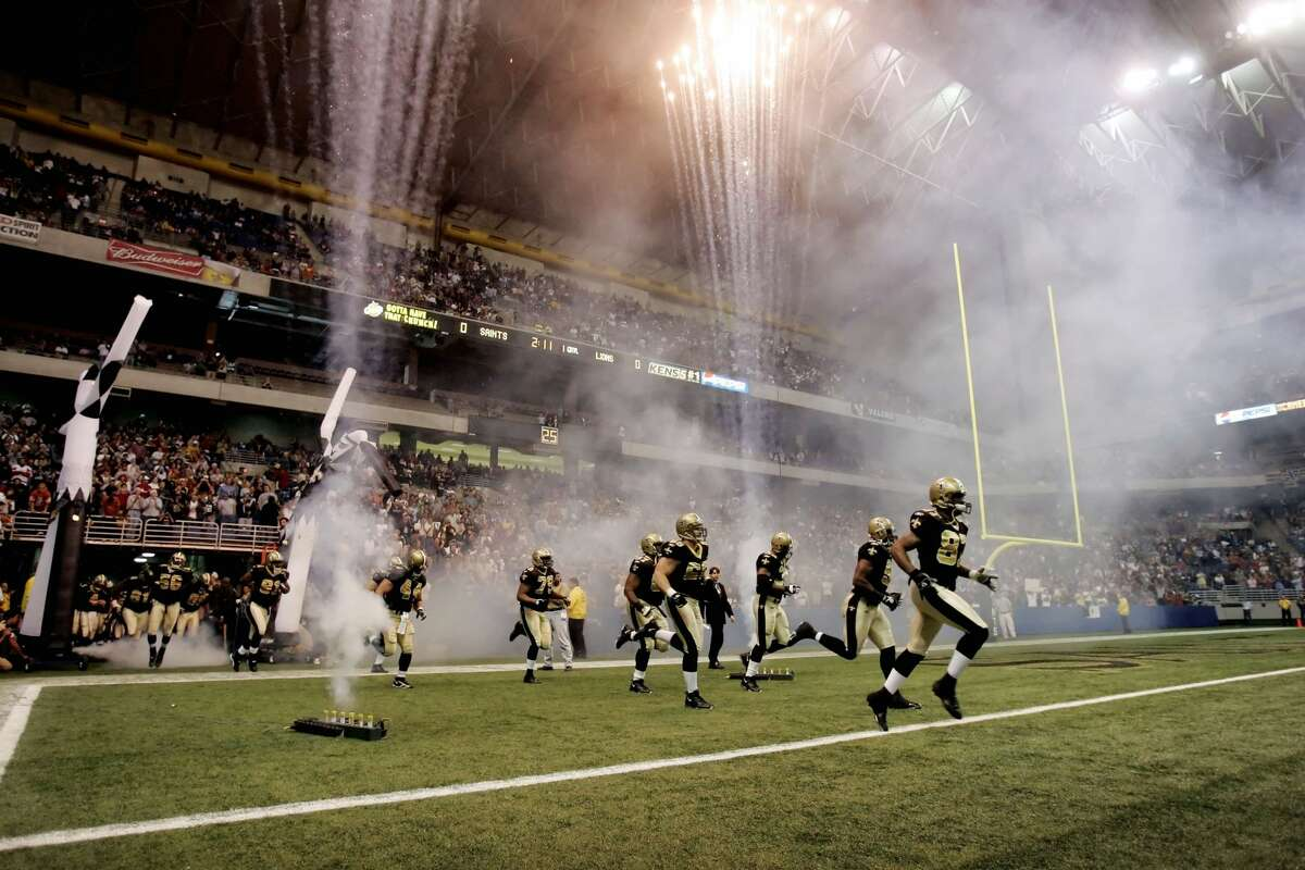 New Orleans Saints players run onto the field at the Alamodome for an NFL game against the Detroit Lions in San Antonio on Dec. 24, 2005. The Lions won 13-12. The Saints played three games in San Antonio following Hurricane Katrina.