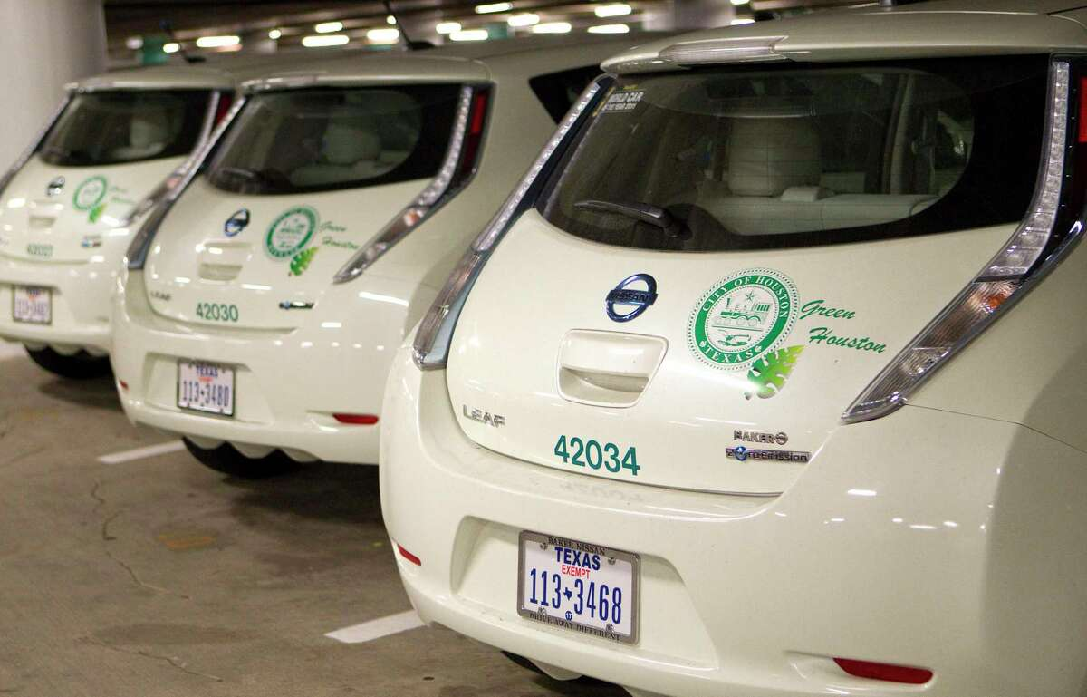 Houston-owned Nissan Leafs sit parked in the City Hall parking garage on Aug. 21, 2012, in Houston. The first wave of electric vehicles were destroyed by Harvey, but city officials are now making plans to convert all city fleet cars and light duty trucks to electric by 2030.