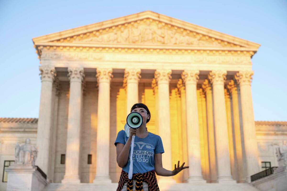 WASHINGTON, DC - SEPTEMBER 02: An activist, who declined to provide her name, speaks outside the Supreme Court in protest against the new Texas abortion law that prohibits the procedure around six weeks into a pregnancy on September 2, 2021 in Washington, DC. The Supreme Court declined to block the law and will let the legal battle play out in the lower courts. (Photo by Drew Angerer/Getty Images)