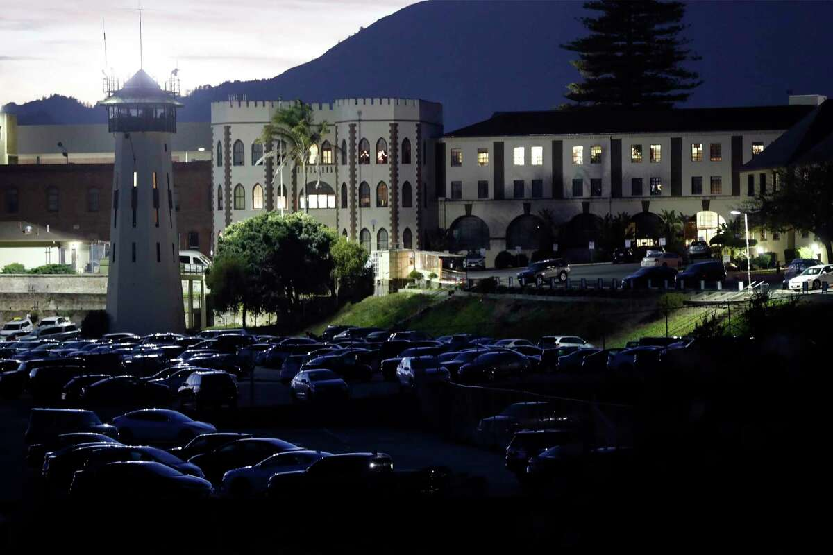 A San Quentin State Prison guard and two others faced federal charges this week in a plot to smuggle phones to inmates, prosecutors and investigators say.