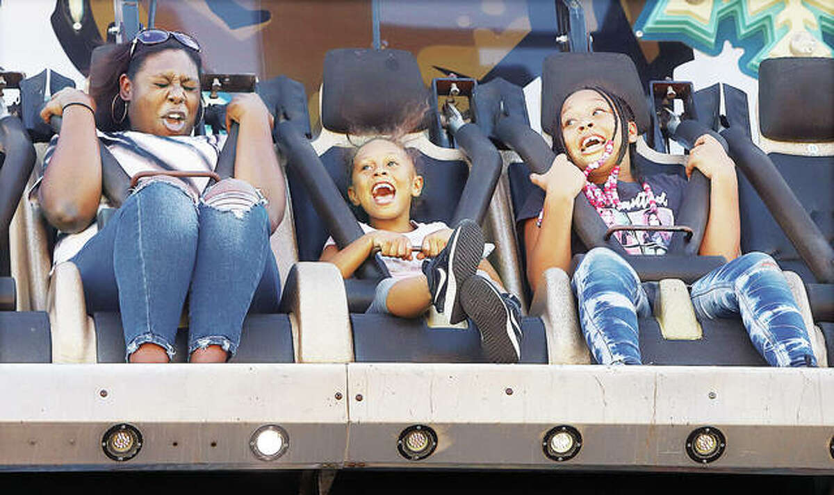 April Warren, left, and her two nieces - Kaliyah Warren, 7, center, and Kimora Curtis, 10, right - all of Alton, screamed through their entire ride on the Avalanche Wednesday night at the Alton Expo in Riverfront Park. The Alton Expo offers entertainment, rides and food through Sunday.