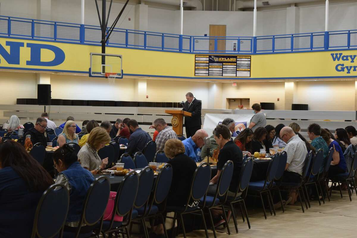 Wayland Baptist University President Bobby Hall says a prayer to open the annual Plainview Area United Way campaign kickoff luncheon.