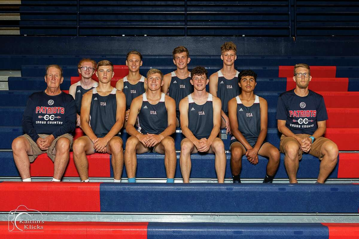 The USA Boys Cross Country team poses for a photo. (Kaitlin Gunsell of Kaitlin's Klicks/For the Tribune)