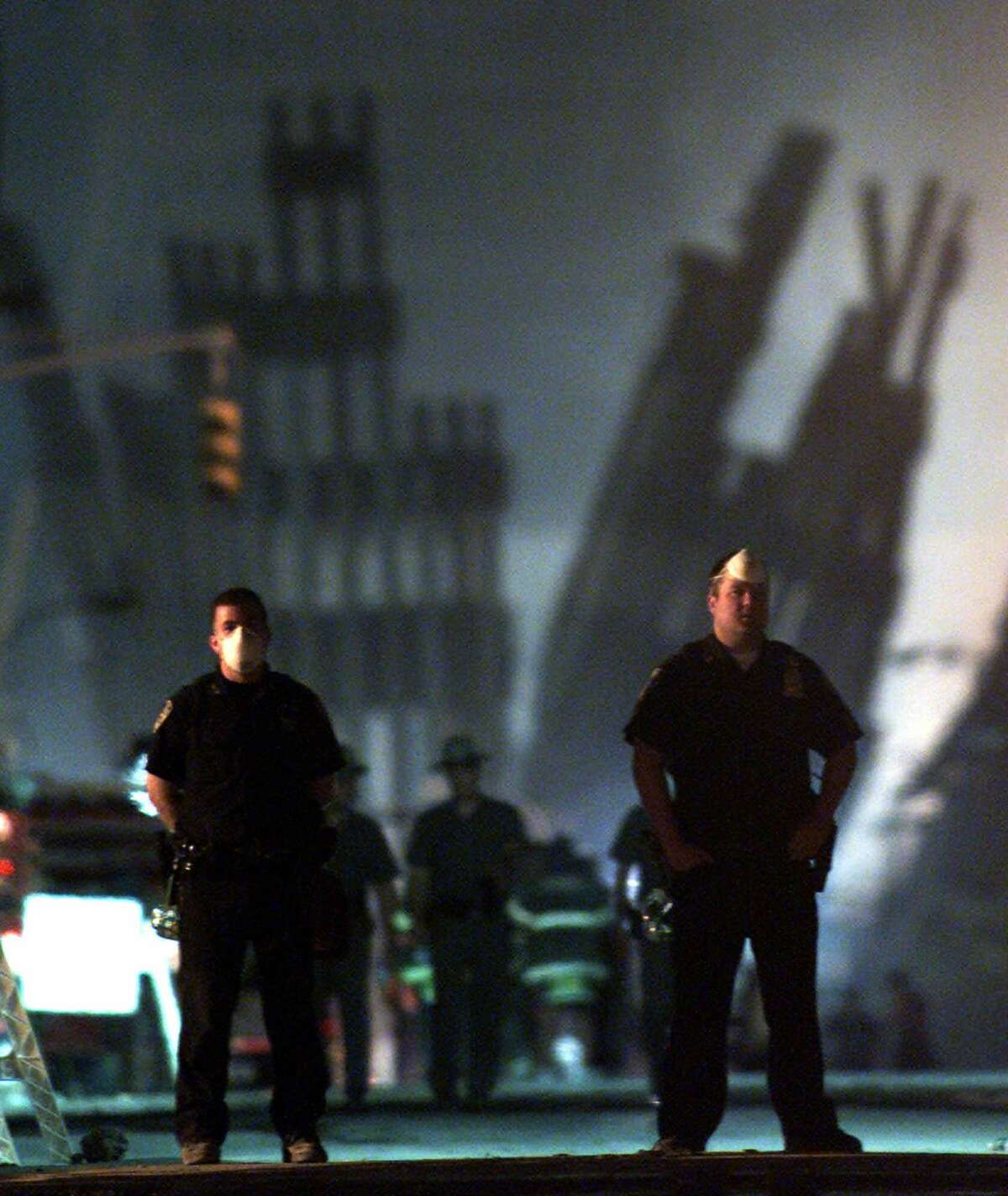 Police officers stand guard near the site of the World Trade Center in New York, in this Sept. 12, 2001, file photo.