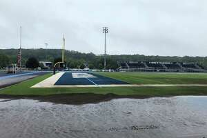A portion of the newly renovated Wilton High School track filled with sand as a result of the overflow from Ida.