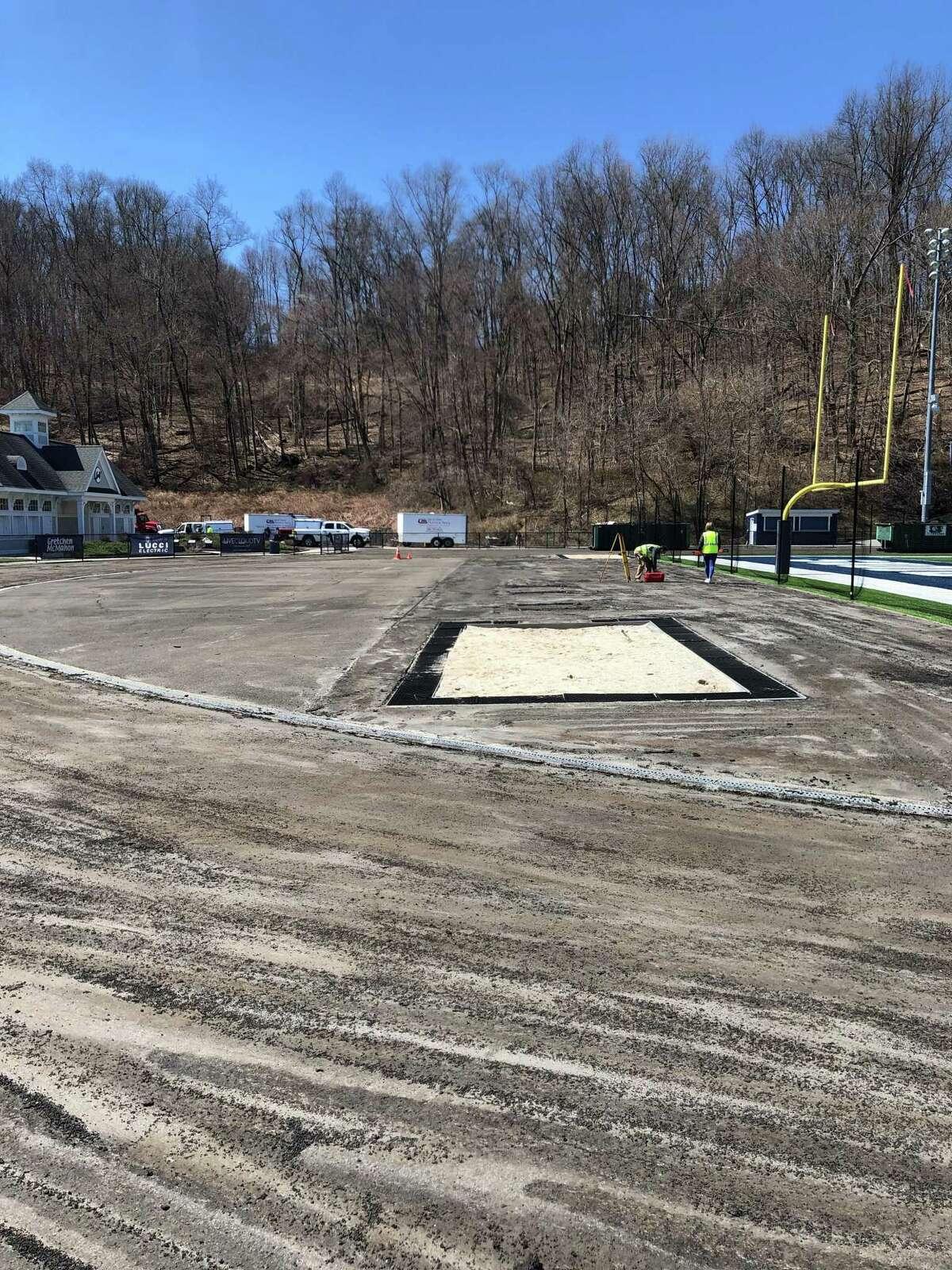 Last week's storm damaged Wilton's newly renovated track at Veterans Memorial Stadium.