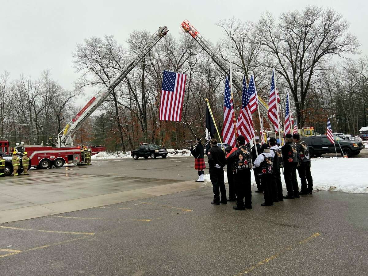 In this file photo, Manistee County first responders gather at the Norman Township Fire Department onJan. 16 to honor the loss of first responder Jerry Self, who died from COVID-19 on Jan. 7. On Thursday, Self was honoredduring the Michigan House's Sept. 11 ceremony at the state Capitol. (File photo)
