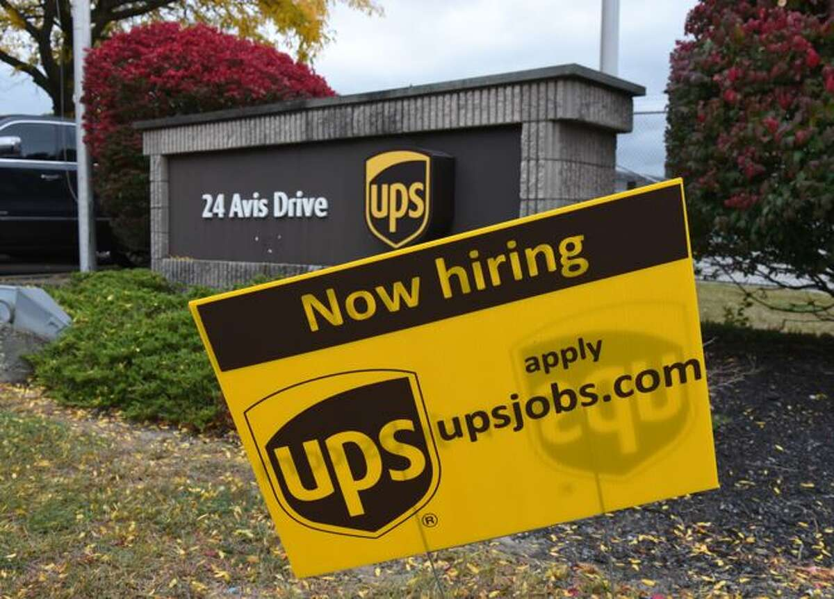 UPS is hiring for the holidays. They say they can hire people within 30 minutes of an application.