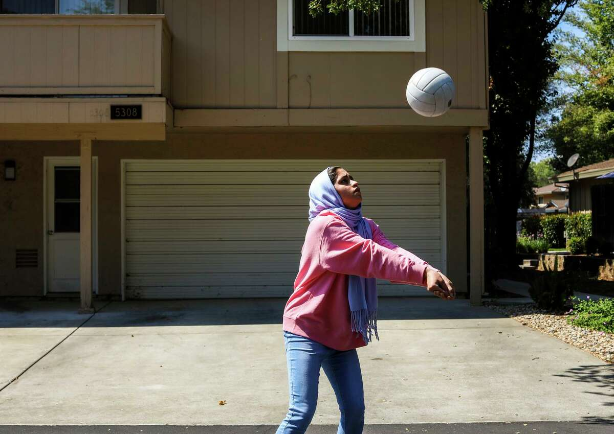 Ghazal Saeedi, 15, practices volleyball in the street outside her home in Sacramento. Though she was born four years after the events of Sept. 11, 2001, they have shaped her life in ways big and small. Because of the work her father did with the U.S. government following the invasion of Afghanistan, her family received special visas to move to California in October 2016, weeks before the election of a U.S. president who appealed to the fatigue over the wars in Afghanistan and Iraq and the fear of immigrants.