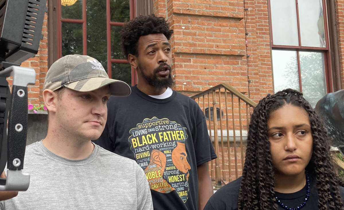 From left, Alex Patterson, Lexis Figuereo and Samira Sangare speak on the steps of City Hall in Saratoga Springs on Thursday, Sept. 9, 2021, after six people were arrested this week for blocking Broadway traffic back in July.