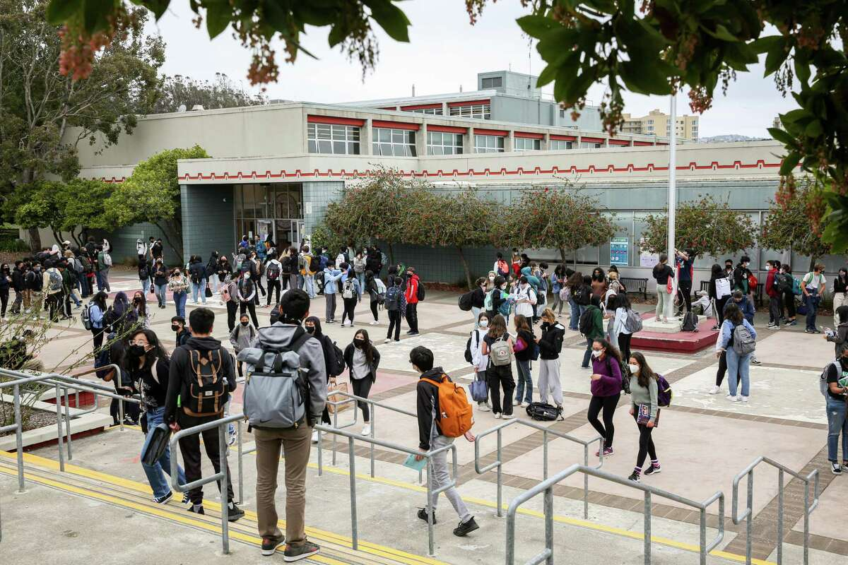 Students gather in the courtyard of Lowell High School in late August as classes let out for the day. Few San Francisco children have been hospitalized for COVID-19 during the course of the pandemic.
