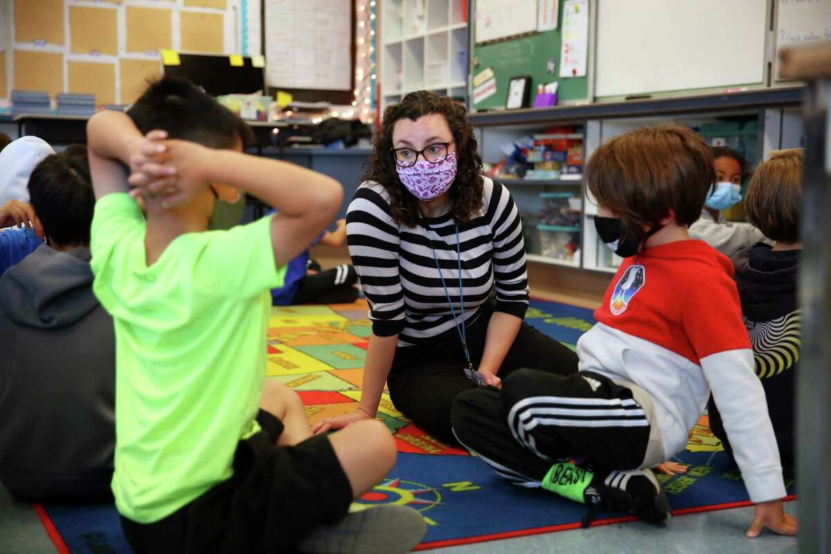 Argonne Elementary teacher Erin Flathers talks with fourth-graders in July on the first day of class.