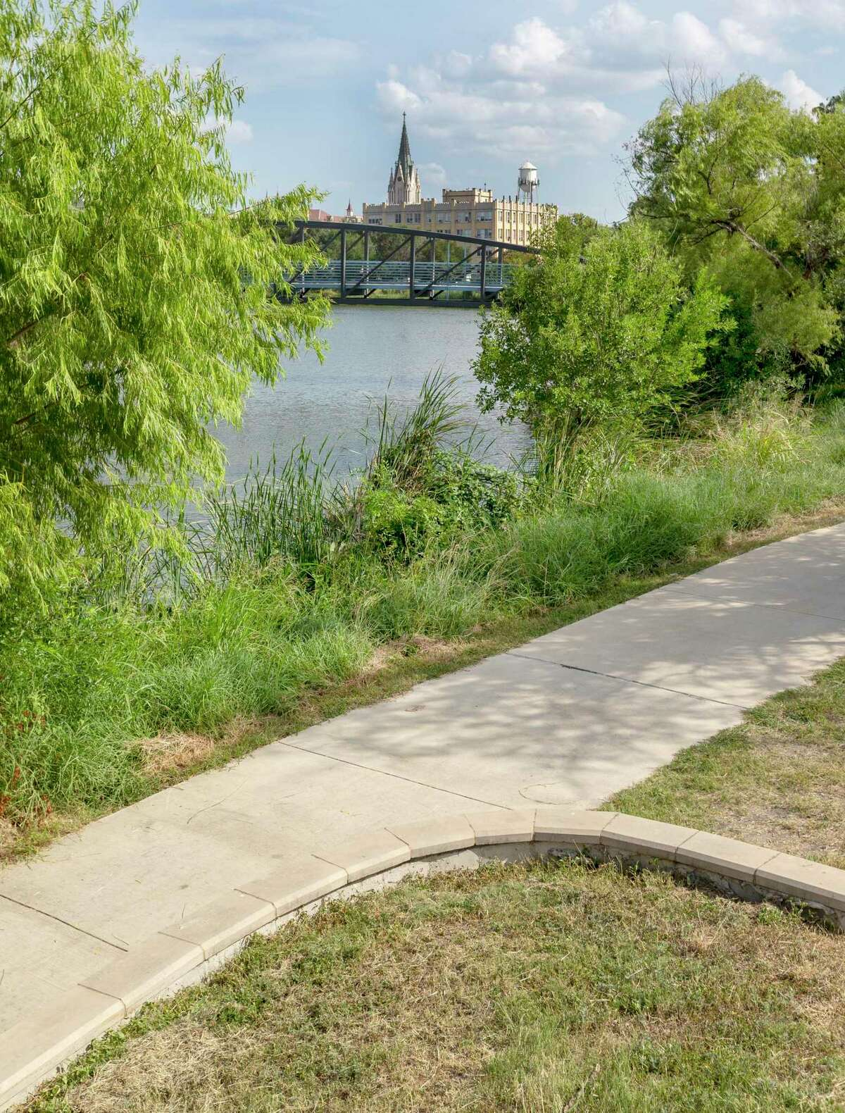 The Apache/Zarzamora Creek Linear Park trail is seen Sept. 3, 2021, as it runs along the West Side near Our Lady of the Lake University.