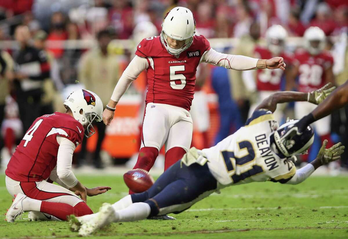 Deer Park High alumni Zane Gonzalez, shown kicking an extra point for the Arizona Cardinals in 2019, was recently cut by the Detroit Lions. He has played in the NFL for five years.