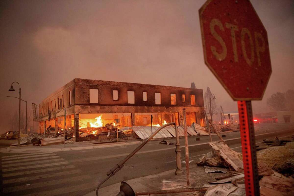 Buildings are left in ruin as the Dixie fire tears through downtown Greenville on Aug. 4. On Thursday, Cal Fire said the Dixie Fire had reached 927,320 acres and was 59% contained, but a red flag warning indicated critical fire weather was expected.