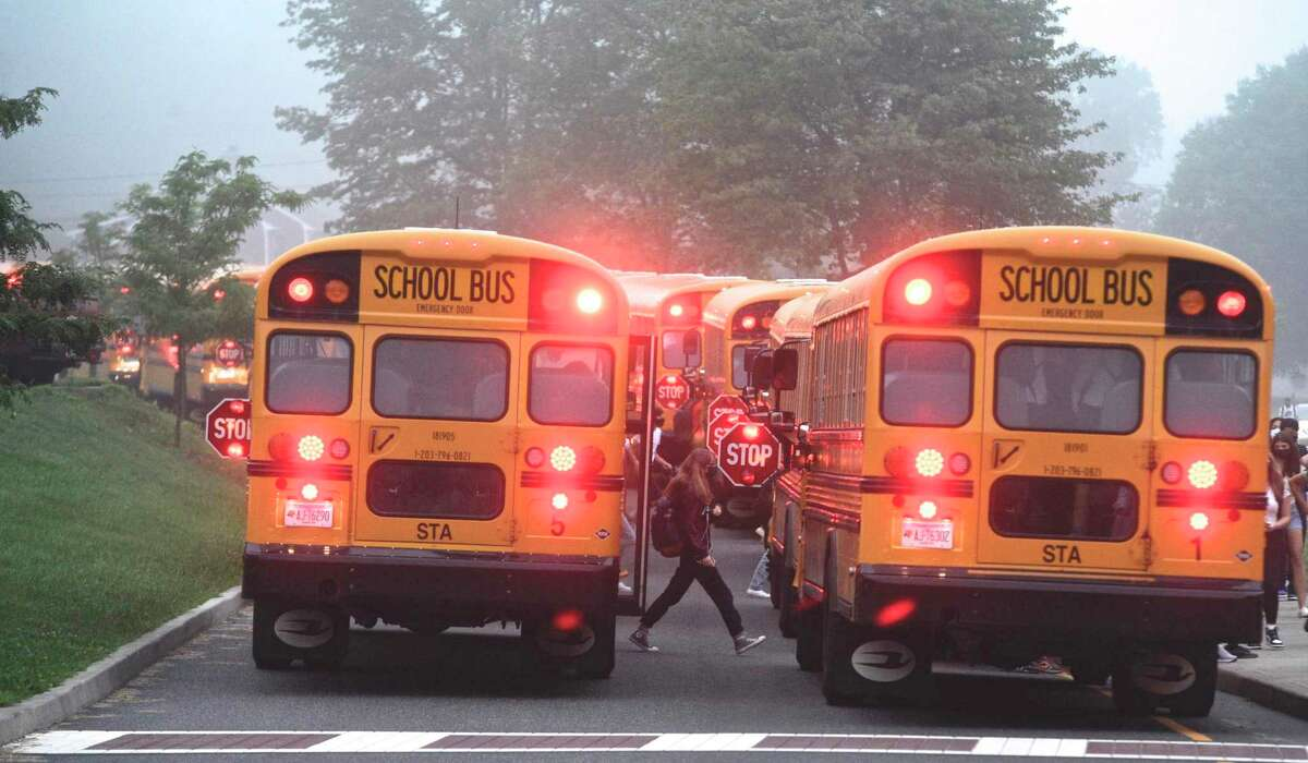 Students head into Danbury High School on the first day of the new school year. Monday, August 30, 2021, Danbury, Conn.