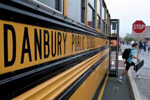 Students get of the busses at Danbury High School on the first day of the new school year. Monday, August 30, 2021, in Danbury and Brookfield, Conn.