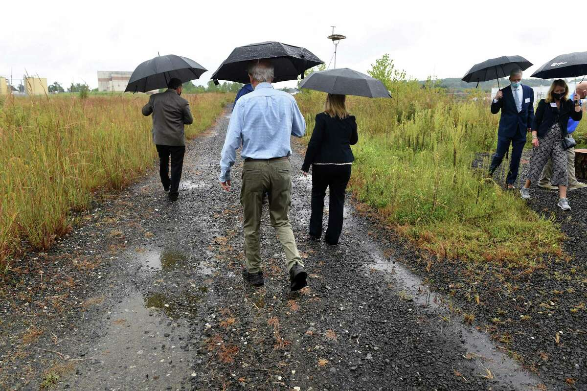 People walk one of the trails during the opening of Brick Yard Point in North Haven on Sept. 9, 2021.