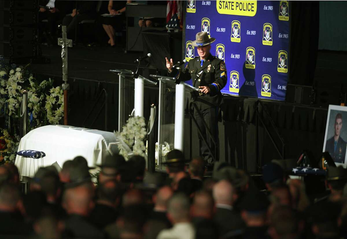 State Police Sgt. Corey Craft shares personal stories during his eulogy of Sgt. Brian Mohl, who was swept away in flood waters in Woodbury from the remnants of Hurricane Ida, during Mohl's funeral service at the Xfinity Theatre in Hartford, Conn. on Thursday, September 9, 2021.