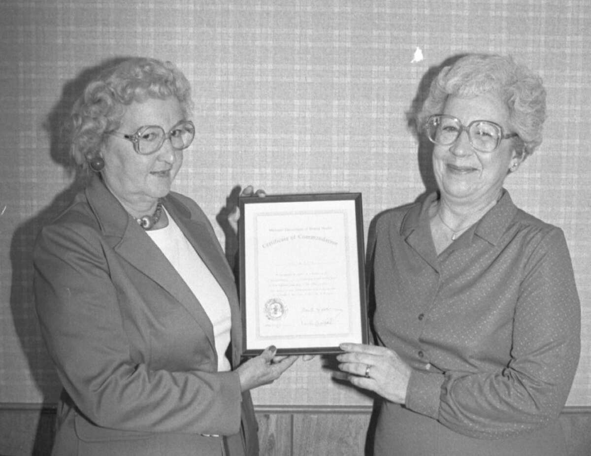Manistee-Benzie Community Mental Health board chairman, Betty Noteware (left) presents former board member Wilma McIntosh (right) with a certificate of appreciation for her work on the Mental Health Board. The photo was published in the News Advocate on Sept. 11, 1981. (Manistee County Historical Museum photo)