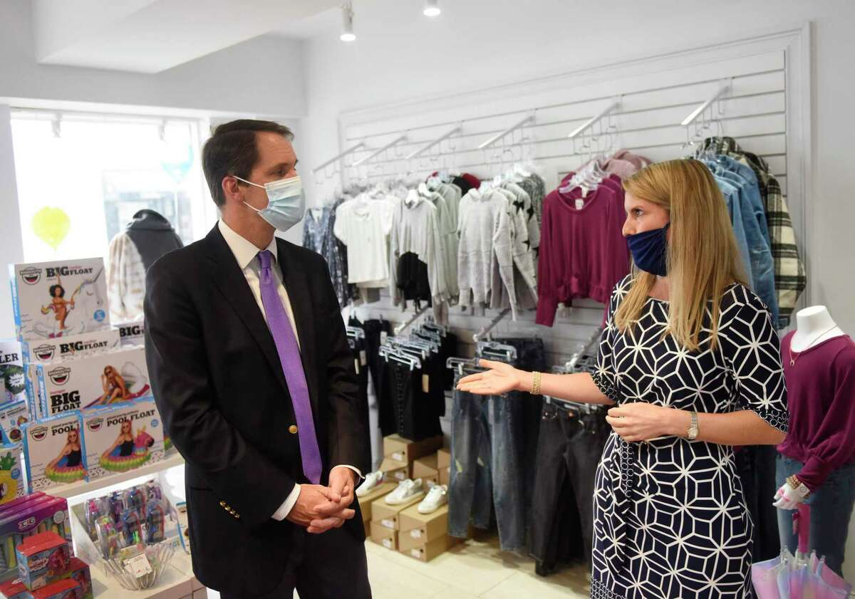 """U.S. Rep. Jim Himes, D-Conn., chats with business owner Sonia Malloy at SPLURGE gift shop in Greenwich, Conn. Thursday, Sept. 9, 2021. Rep. Himes visited SPLURGE and Tiger Lily's interior design studio as part of the Goldman Sachs 10,000 Small Business Voices """"Road to Recovery"""" Tour. The visits were part of a nationwide tour to discuss challenges that small businesses are still facing because of COVID."""